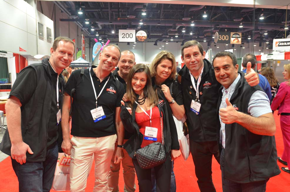 Pizza Expo 2014 attendees on show floor2