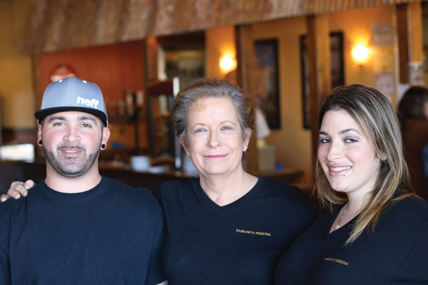 Owner Nancy Pezzi with son, John, and daughter, Kathryn, who have taken active roles in the business.