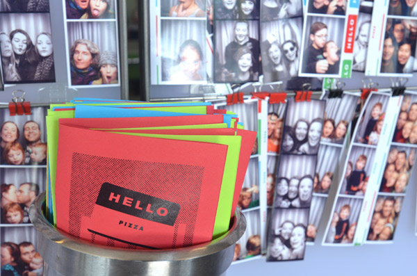 Customers at Hello Pizza in Minneapolis take photos in a photobooth, which are then posted around the shop.